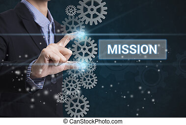 Businessman hand select wording mission. sign on virtual screen. business concept.
