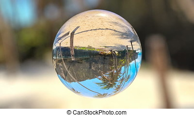 Beautiful Tropical Landscape seen through a Glass Orb, seamless loop