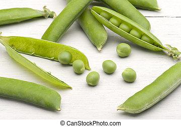 Fresh Peas - Freshly Picked Garden Peas On A Kitchen Table
