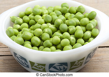 Fresh Peas - Freshly Podded Garden Peas In A Dish