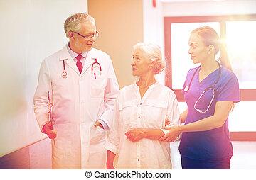 medics and senior patient woman at hospital - medicine, age,...