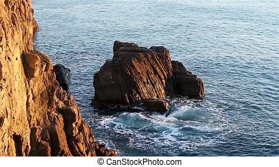 View rocky coast Ligurian Sea - View of waves splashing on...