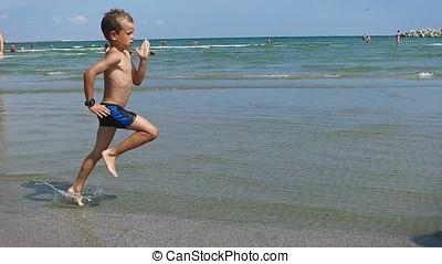 Little boy running on the beach, Constanta, Romania, slow...