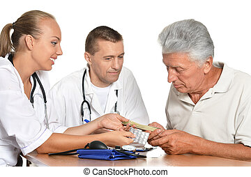 man and woman doctors with patient