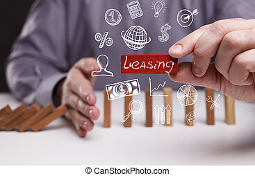 Business, Technology, Internet and network concept. Young businessman shows the word: Leasing