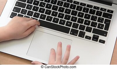 Footage of a kids finger using a laptop touch pad. child...