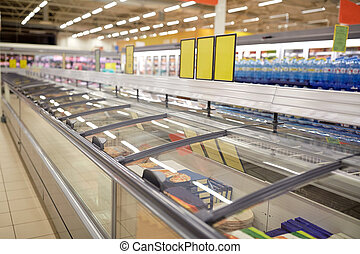 freezers at grocery store - sale, shopping, consumerism and...