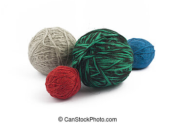 Four balls of wool on white background