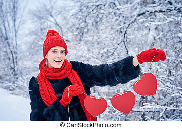 Love and valentines day concept. Happy excited woman holding...