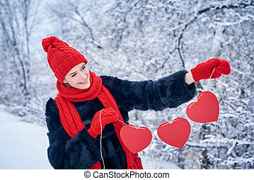 Love and valentines day concept. Smiling woman holding...