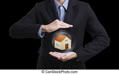 business salesman hand holding protection home concept home...