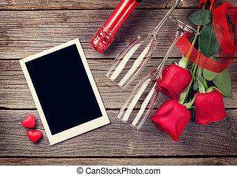 Valentines day photo frame, champagne and red roses on...