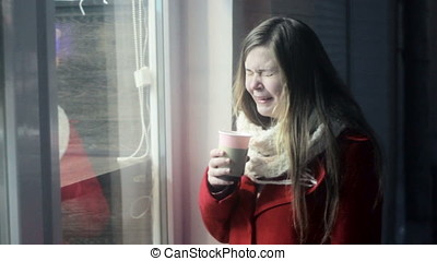 Young upset girl remembering ex-boyfriend and drinking tea -...