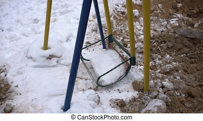 Children's swing in the playground - Children's swing in an...