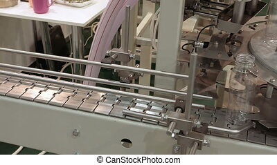 Conveyor product line for pouring beverage bottles -...