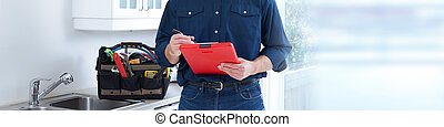 Plumber hands with clipboard. - Professional plumber doing...