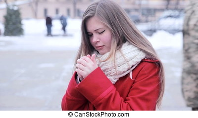 Young girl warm her hands