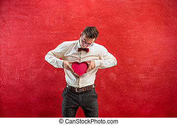 Young funny man with abstract heart - The young funny man...