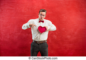 Young funny man with abstract heart and clock - The young...