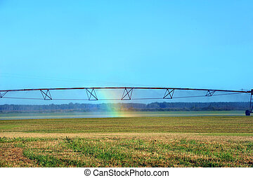 Agriculture Hope in Rainbow - Rainbow forms in irrigation...