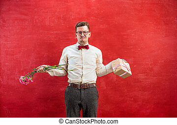 Young young funny man with flowers and gift - Young...