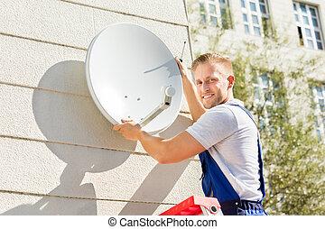 Man Fitting TV Satellite Dish
