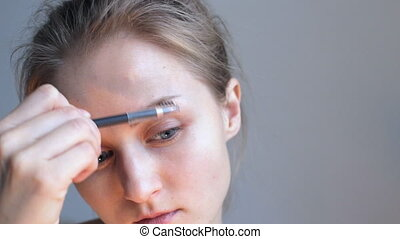 Woman making eyebrow correction - Caucasian beautiful woman...