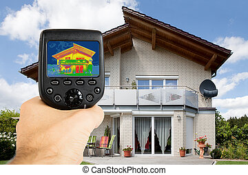 Person Using Infrared Thermal Camera Outside The House -...