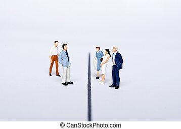 miniature people on team