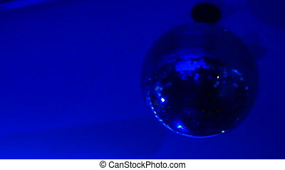 Shining bright blue mirror disco ball. Interesting device for discotheque dancing party with music in night club.