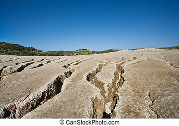 Muddy volcanoes soil - Landscape with cracked soil from...