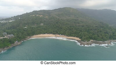 Aerial drone flight footage over beach and sea in Phuket,...