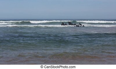 Ocean surf and small rocks formations. - Sea surf waves and...