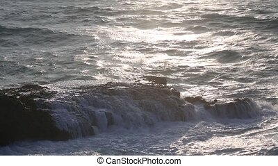 Atlantic ocean waves and sun reflection. - Waves breaking on...