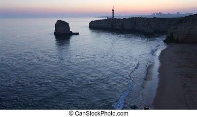 Sea coast sunset landscape and lighthouse. - Sea coast...