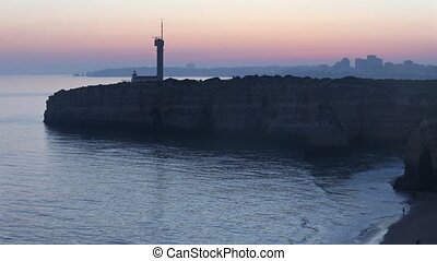 Sea coast sunset landscape and lighthouse. - Sea coast...