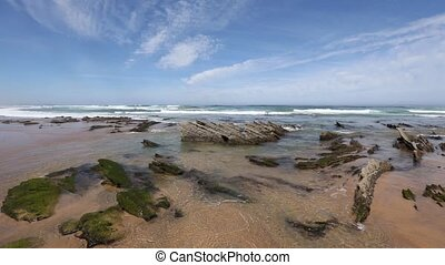 Small rocks formations on sandy beach. - Atlantic sandy...