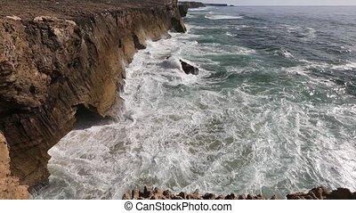 Waves breaking on rocky coast. - Waves breaking on rocky...