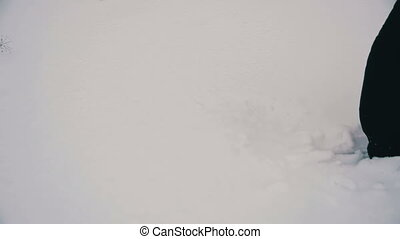 Man Walking in the Deep Snow. Slow Motion - Man Walking in...