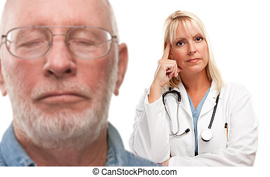 Concerned Senior Man and Female Doctor Behind