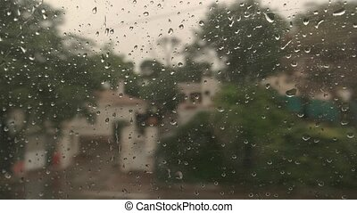 Train window and water droplets.