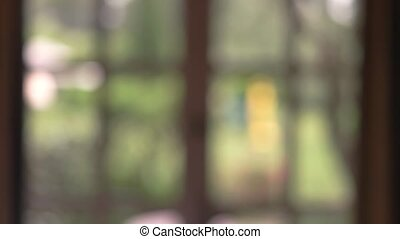 Blurred window backdrop. Unfocused nature background....