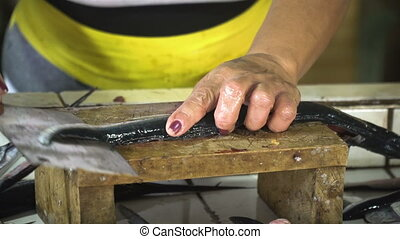 Cutting fish at a street market. - Hand cutting fish at the...