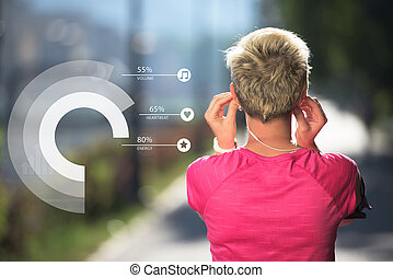 Young fit woman listening music - Young fit woman take a...