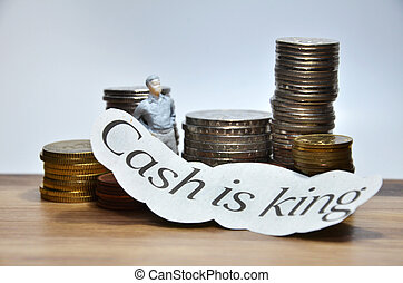 Cash is King words with many coins
