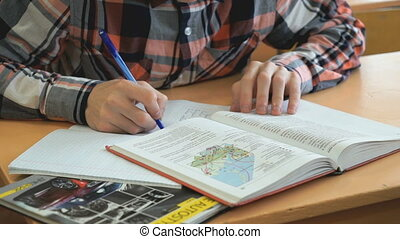 Pupil writes the text in exercise book on lesson - Pupil...