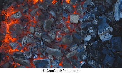 Coal burning in a brazier grill.