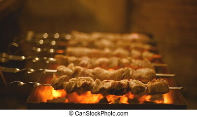 Roasting shish kebabs on the grill. - Roasting pork kebabs...