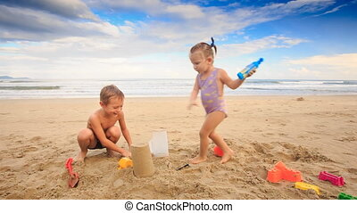 Kids Small Girl Boy Gambol Laugh on Wet Sand Beach - closeup...