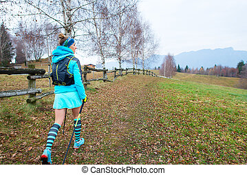 Sporty woman walking in nature